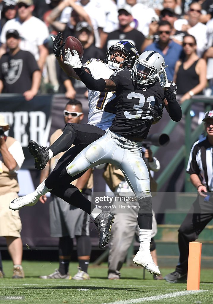 <a gi-track='captionPersonalityLinkClicked' href=/galleries/search?phrase=Neiko+Thorpe&family=editorial&specificpeople=5622719 ng-click='$event.stopPropagation()'>Neiko Thorpe</a> #31 of the Oakland Raiders breaks a pass intended for <a gi-track='captionPersonalityLinkClicked' href=/galleries/search?phrase=Darren+Waller&family=editorial&specificpeople=8583964 ng-click='$event.stopPropagation()'>Darren Waller</a> #12 of the Baltimore Ravens in the second quarter at Oakland-Alameda County Coliseum on September 20, 2015 in Oakland, California.