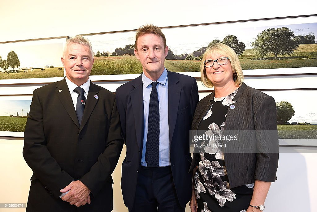 Neil and Sally Pearce and Jolyon Fenwick (C) attend the exhibition launch party of 'The Zero Hour Panoramas' by Jolyon Fenwick. The exhibition consists of 14 photographic panoramas showcasing, '100 Years on: Views From The Parapet of the Somme', at Sladmore Contemporary on June 30, 2016 in London, England.