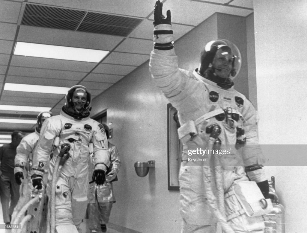 <a gi-track='captionPersonalityLinkClicked' href=/galleries/search?phrase=Neil+Armstrong&family=editorial&specificpeople=92197 ng-click='$event.stopPropagation()'>Neil Armstrong</a> leads Edwin 'Buzz' Aldrin and <a gi-track='captionPersonalityLinkClicked' href=/galleries/search?phrase=Michael+Collins+-+Astronaut&family=editorial&specificpeople=95470 ng-click='$event.stopPropagation()'>Michael Collins</a> out of the space centre on the Apollo 11 space mission to the moon.