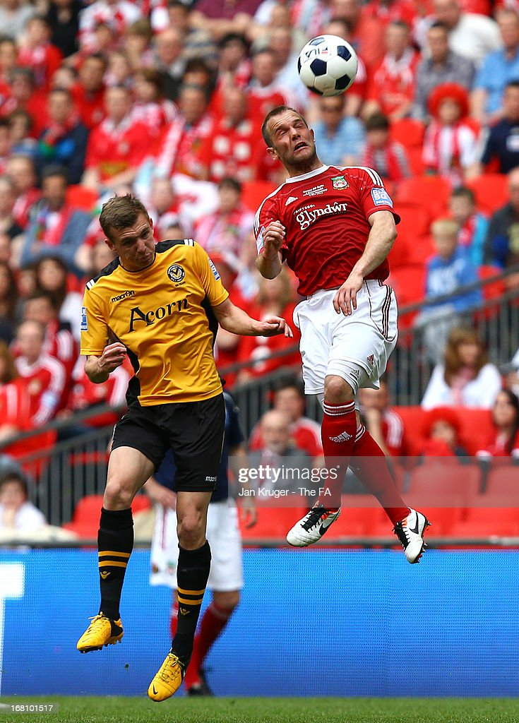Neil Ashton of Wrexham battles for the aerial ball with Alex Gilbey of Newport County during the Conference Premier play-off final match between Wrexham and Newport County at Wembley Stadium on May 5, 2013 in London, England.