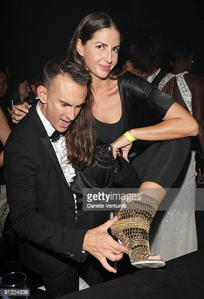 Neil Barrett and Benedetta Mazzini attend amfAR Milano 2009 After Party the Inaugural Milan Fashion Week event at La Permanente on September 28 2009...