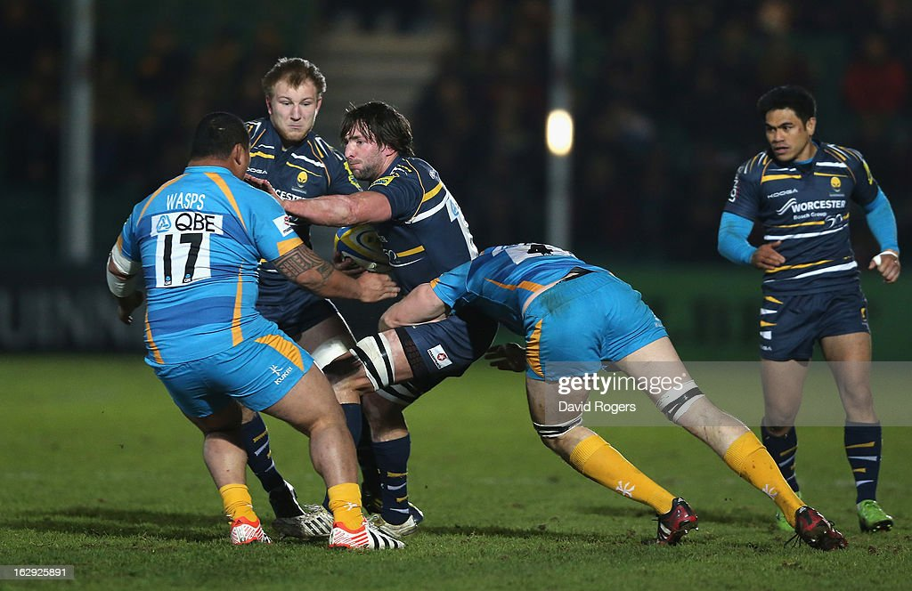 Neil Best of Worcester is held by James Cannon (R) during the Aviva Premiership match between Worcester Warriors and London Wasps at Sixways Stadium on March 1, 2013 in Worcester, England.