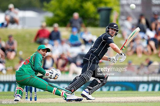 Neil Broom of New Zealand bats as wicketkeeper Nurul Hasan Sohan of Bangladesh looks on during the third One Day International match between New...