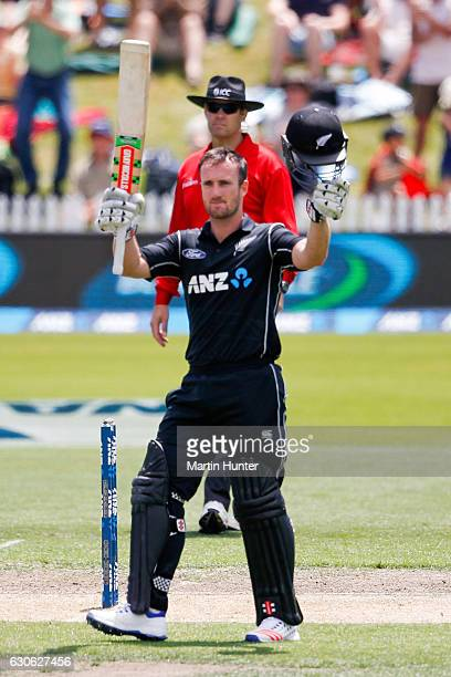 Neil Broom of New Zealand celebrates after reaching a century during the second One Day International match between New Zealand and New Zealand and...