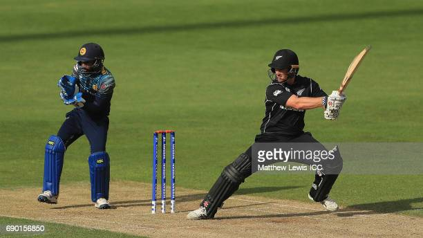 Neil Broom of New Zealand hits the ball towards the boundary as Niroshan Dickwella of Sri Lanka looks on during the ICC Champions Trophy Warmup match...