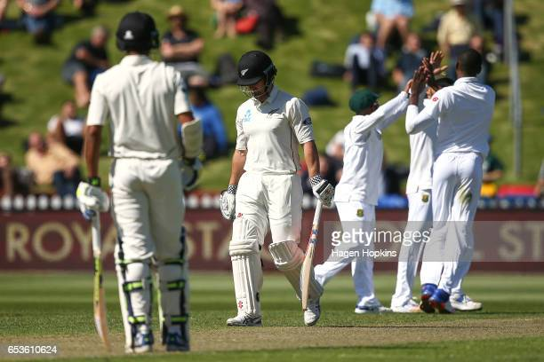 Neil Broom of New Zealand leave sht eifld after being dismissed during day one of the Test match between New Zealand and South Africa at Basin...