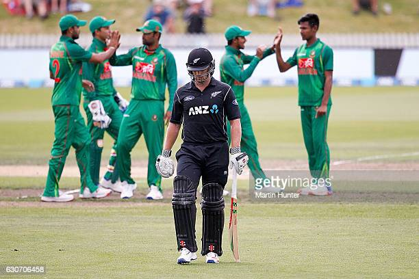 Neil Broom of New Zealand leaves the field as Bangladesh players celebrate during the third One Day International match between New Zealand and...