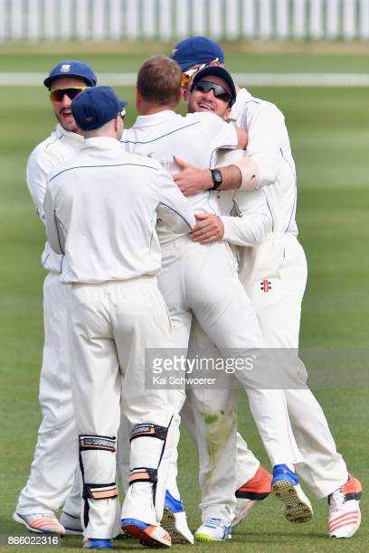 Neil Broom of Otago is congratulated by team mates after dismissing Cameron Fletcher of Canterbury during the Plunket Shield match between Canterbury...