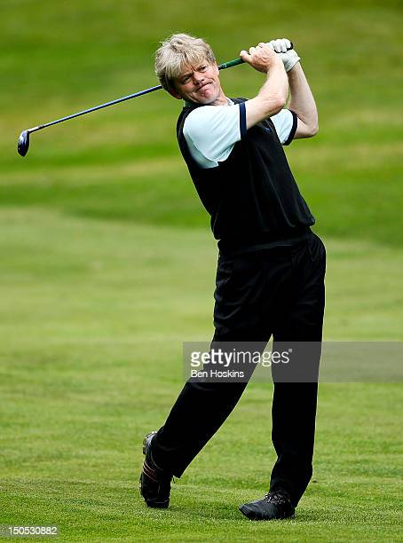 Neil Burke of Horne Park Golf Centre hits an approach shot during the Regional Final of the Virgin Atlantic PGA National ProAm Championship at...