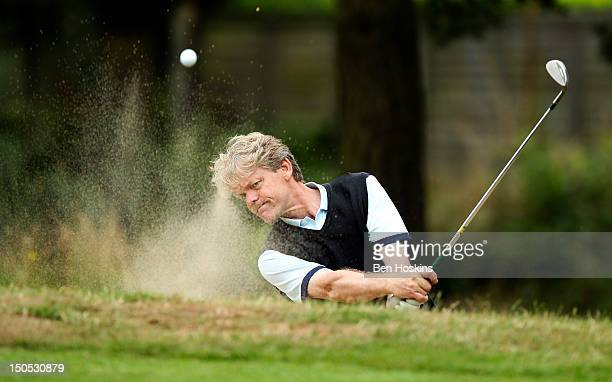 Neil Burke of Horne Park Golf Centre hits out of the sand on the 11th hole during the Regional Final of the Virgin Atlantic PGA National ProAm...