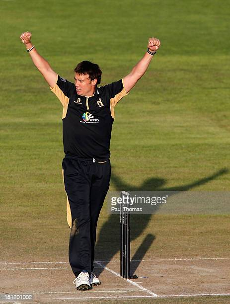 Neil Carter of Warwickshire celebrates after taking the wicket of Lancashire's Paul Norton during the Clydesdale Bank Pro40 semi final match between...