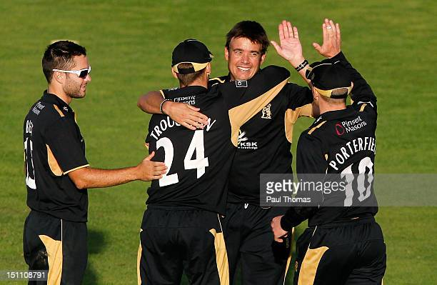 Neil Carter of Warwickshire celebrates with teammates after taking the wicket of Lancashire's Paul Norton during the Clydesdale Bank Pro40 semi final...