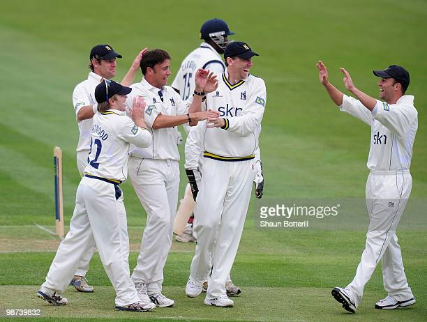 Neil Carter of Warwickshire is congratulated by teammates after taking the wicket of Michael Carberry of Hampshire during the LV County Championship...