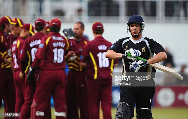 Neil Carter of Warwickshire is dismissed off the bowling of Andrew Hall of Northants during the Friends Life T20 match between Northamptonshire and...