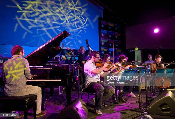 Neil Cowley performs on stage with his Trio and String Quartet at The Jazz Arena during the fifth day of Cheltenham Jazz Festival on May 1 2011 in...
