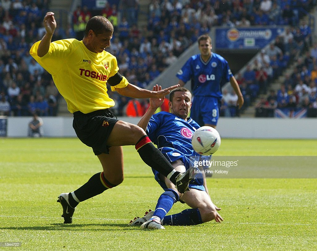 Neil Cox of Watford is challenged by Muzzy Izzet of Leicester City in the Nationwide League Division One match between Leicester City and Watford at the Walkers Stadium in Leicester, England on August 10, 2002. Leicester won 2-0.