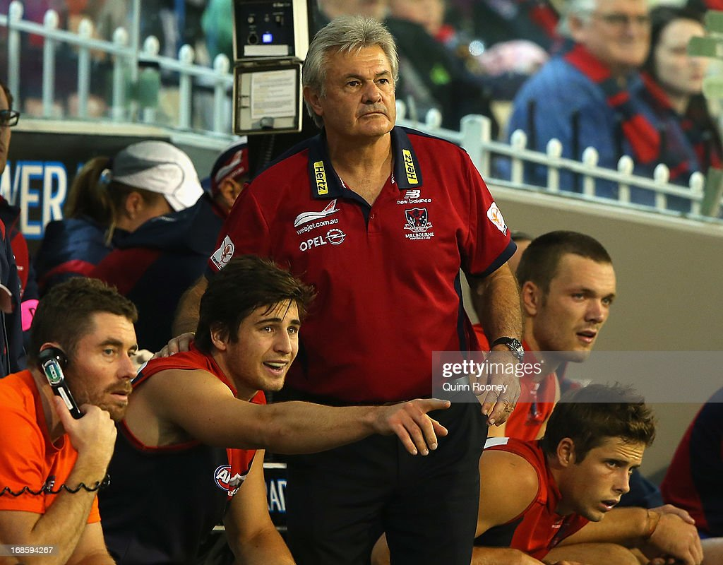 Neil Craig the assistant coach of the Demons gives instructions from the bench during the round seven AFL match between the Melbourne Demons and the Gold Coast Suns at Melbourne Cricket Ground on May 12, 2013 in Melbourne, Australia.