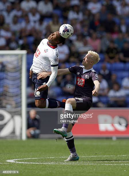 Neil Danns of Bolton Wanderers and Will Hughes of Derby County contest a header during the Sky Bet Championship match between Bolton Wanderers and...