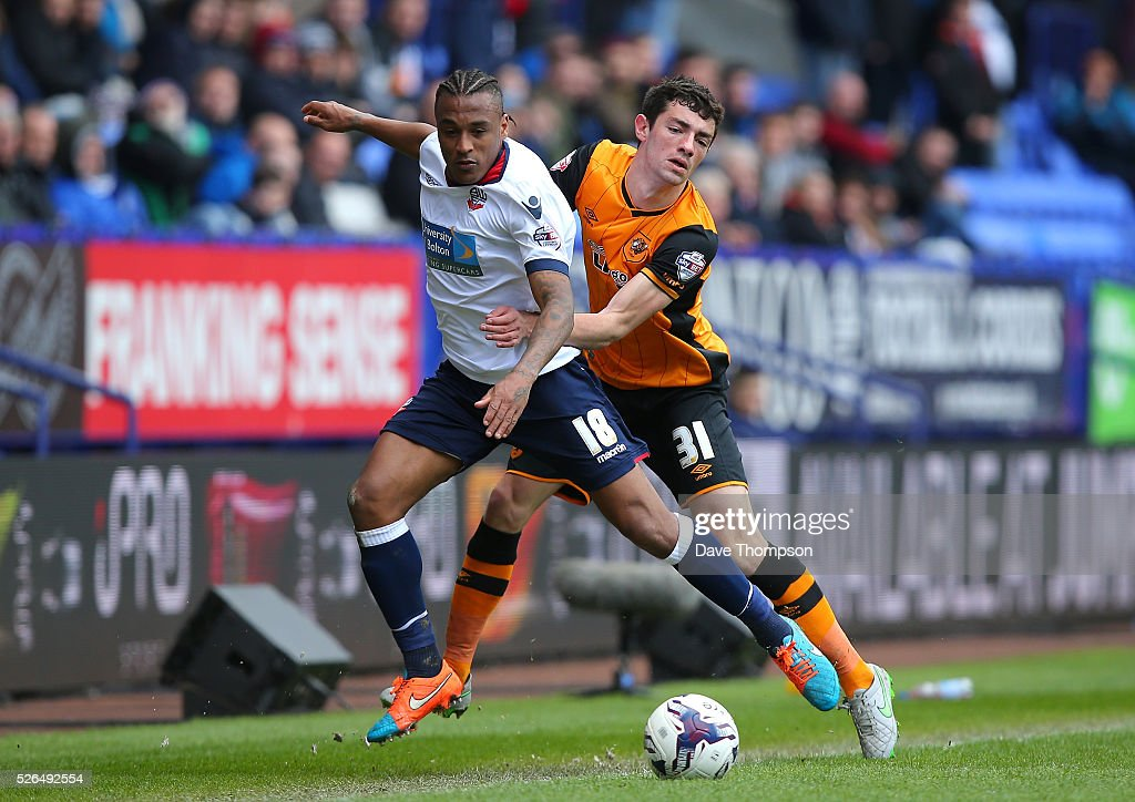 Neil Danns of Bolton Wanderers controls the ball under pressure of Brian Lenihan of Hull City during the Sky Bet Championship match between Bolton Wanderers and Hull City at the Macron Stadium on April 30, 2016 in Bolton, United Kingdom.