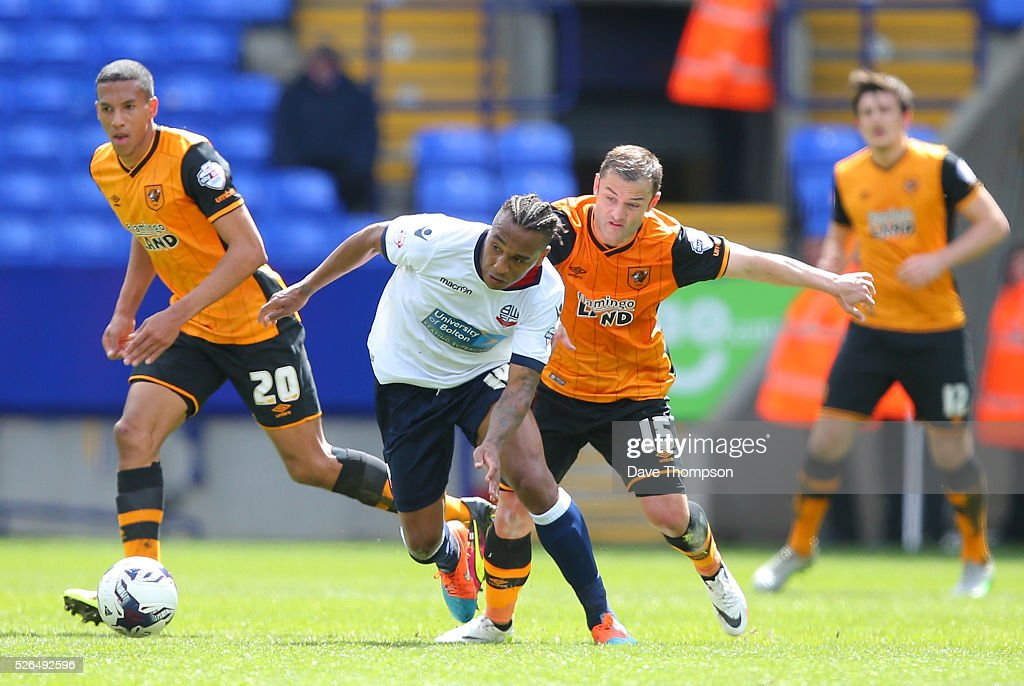 Neil Danns of Bolton Wanderers controls the ball under pressure of Shaun Maloney of Hull City during the Sky Bet Championship match between Bolton Wanderers and Hull City at the Macron Stadium on April 30, 2016 in Bolton, United Kingdom.
