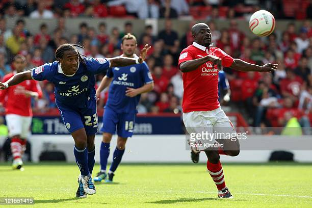 Neil Danns of Leicester is challengewd by Georg Boateng of Nottingham Forest during the npower Championship match between Nottingham Forest and...
