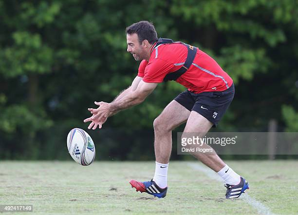 Neil de Kock attempts to pick up the loose ball during the Saracens training session on May 20 2014 in St Albans England
