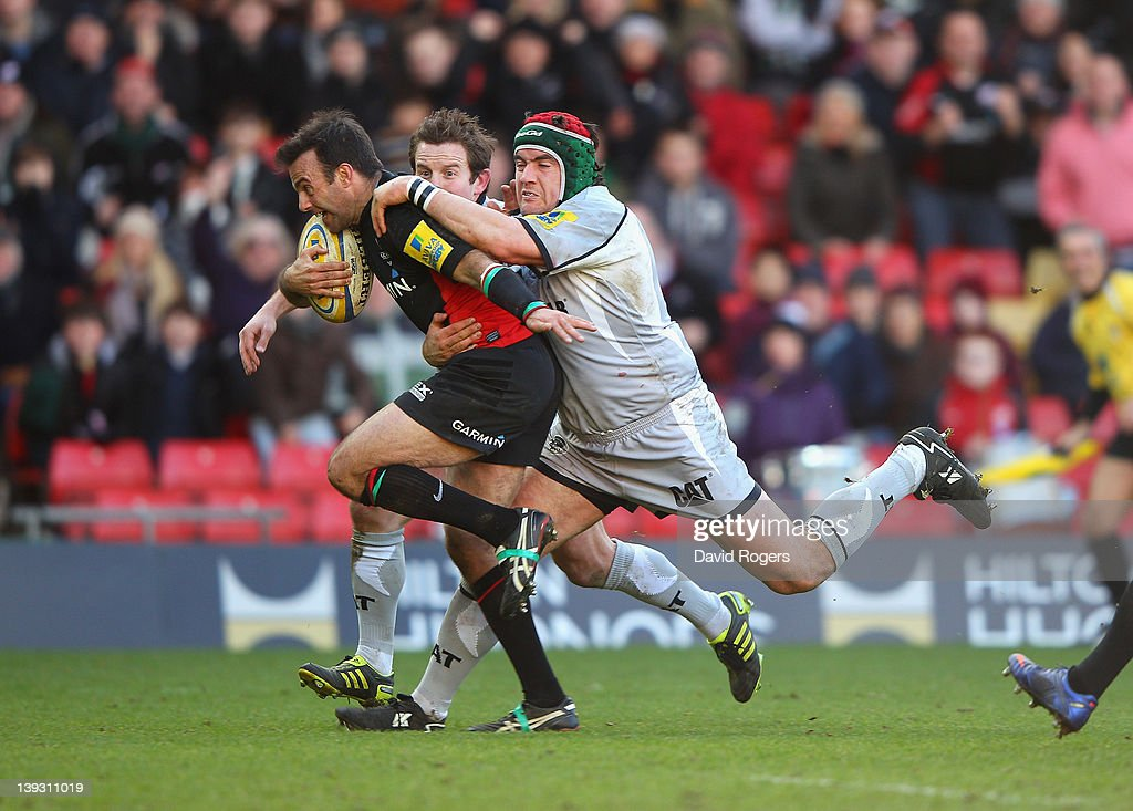 <a gi-track='captionPersonalityLinkClicked' href=/galleries/search?phrase=Neil+de+Kock&family=editorial&specificpeople=4220314 ng-click='$event.stopPropagation()'>Neil de Kock</a> of Saracens breaks clear of the the tackle from <a gi-track='captionPersonalityLinkClicked' href=/galleries/search?phrase=Marcos+Ayerza&family=editorial&specificpeople=3034035 ng-click='$event.stopPropagation()'>Marcos Ayerza</a> to score the first try during the Aviva Premiership match between Saracens and Leicester Tigers at Vicarage Road on February 19, 2012 in Watford, England.