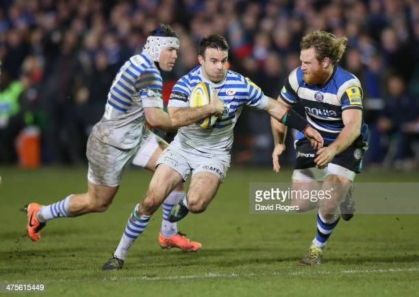 Neil de Kock of Saracens breaks past Ross Batty during the Aviva Premiership match between Bath and Saracens at the Recreation Ground on February 28...