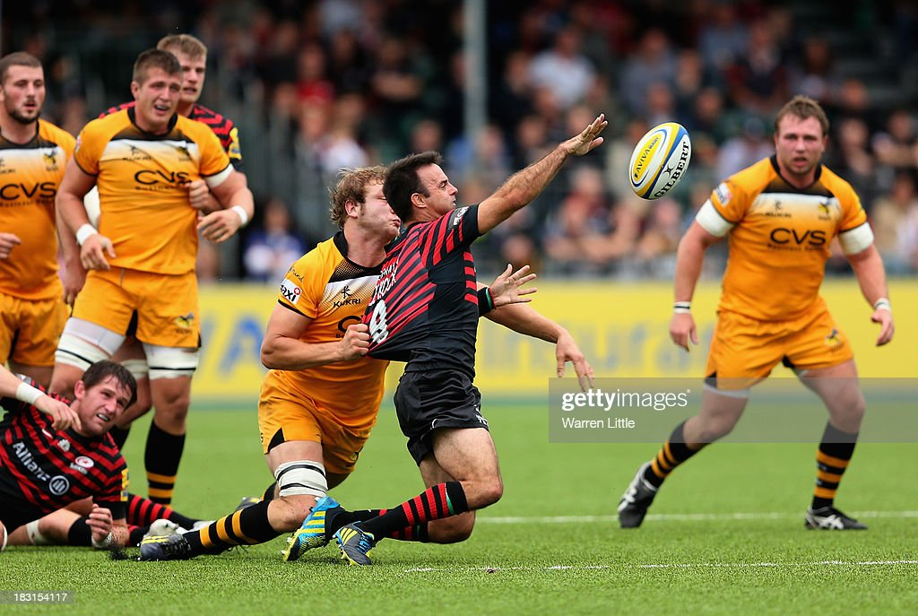 Neil De Kock of Saracens is tackled by <a gi-track='captionPersonalityLinkClicked' href=/galleries/search?phrase=Joe+Launchbury&family=editorial&specificpeople=7440712 ng-click='$event.stopPropagation()'>Joe Launchbury</a> of London Wasps during the Aviva Premiership match between Saracens and London Wasps at Allianz Park on October 5, 2013 in Barnet, England.