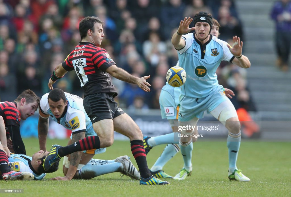 Neil de Kock of Saracens kicks the ball past Tom Wood during the Aviva Premiership match between Saracens and Northampton Saints at stadiumMK on December 30, 2012 in Milton Keynes, England.