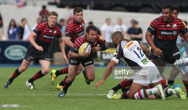 Neil de Kock of Saracens takes on Jordan TurnerHall during the Aviva Premiership semi final match between Saracens and Harlequins at Allianz Park on...