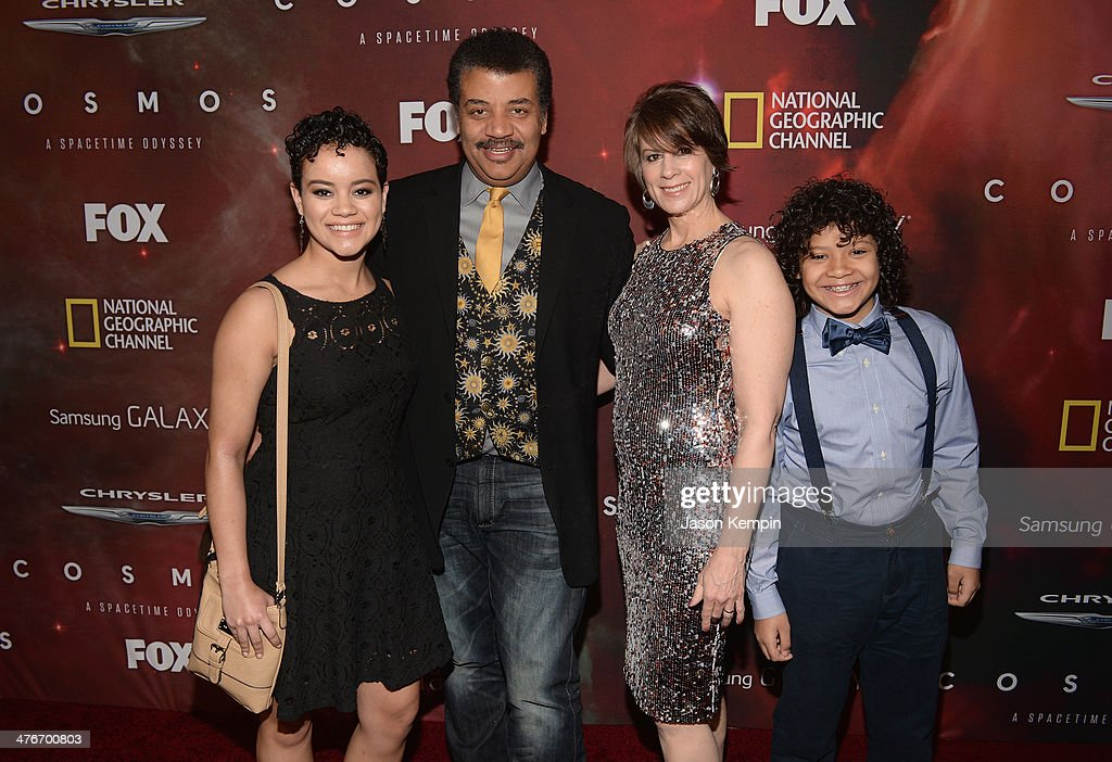 Neil deGrasse Tyson (2nd left) with daugther, Miranda Tyson (L), wife, Alice Young (2nd right), and son, Travis Tyson attend the premiere of Fox's 'Cosmos: A SpaceTime Odyssey' at The Greek Theatre on March 4, 2014 in Los Angeles, California.