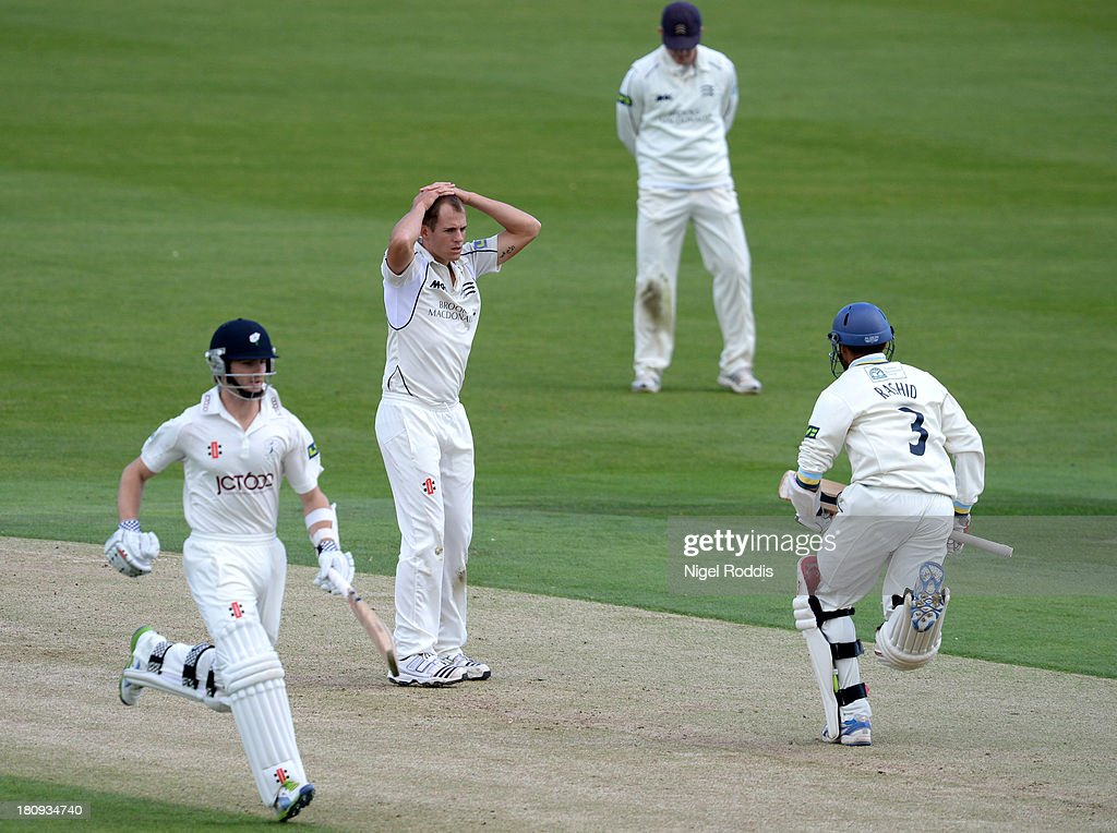 Neil Dexter (C) of Middlesex reacts as Kane Williamson (L) and Adil Rashid take a run during day two of the LV County Championship Division One match between Yorkshire and Middlesex at Headingley Stadium on September 18, 2013 in Leeds, England.