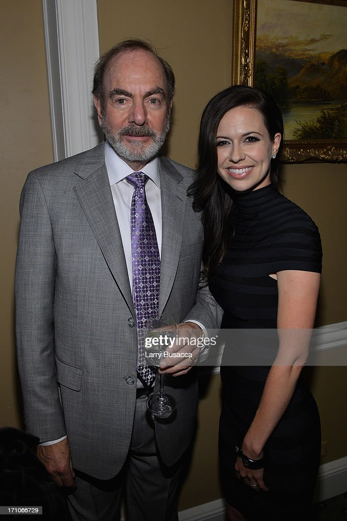 Neil Diamond and Joy Williams attend a luncheon honoring Rob Stringer as UJA-Federation of New York Music Visionary of 2013 at The Pierre Hotel on June 21, 2013 in New York City.