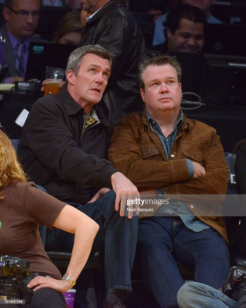 Neil Flynn (L) and <a gi-track='captionPersonalityLinkClicked' href=/galleries/search?phrase=Eric+Stonestreet&family=editorial&specificpeople=6129010 ng-click='$event.stopPropagation()'>Eric Stonestreet</a> attend a basketball game between the Phoenix Suns and the Los Angeles Lakers at Staples Center on February 12, 2013 in Los Angeles, California.