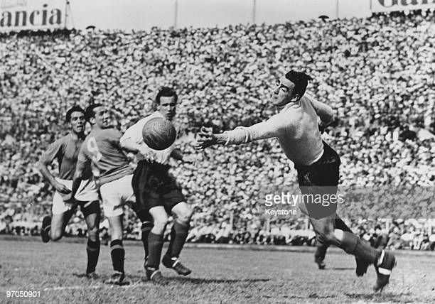 Neil Franklin holds off Italian centreforward Guglielmo Gabetto as England captain and goalkeeper Frank Swift makes a save during an international at...