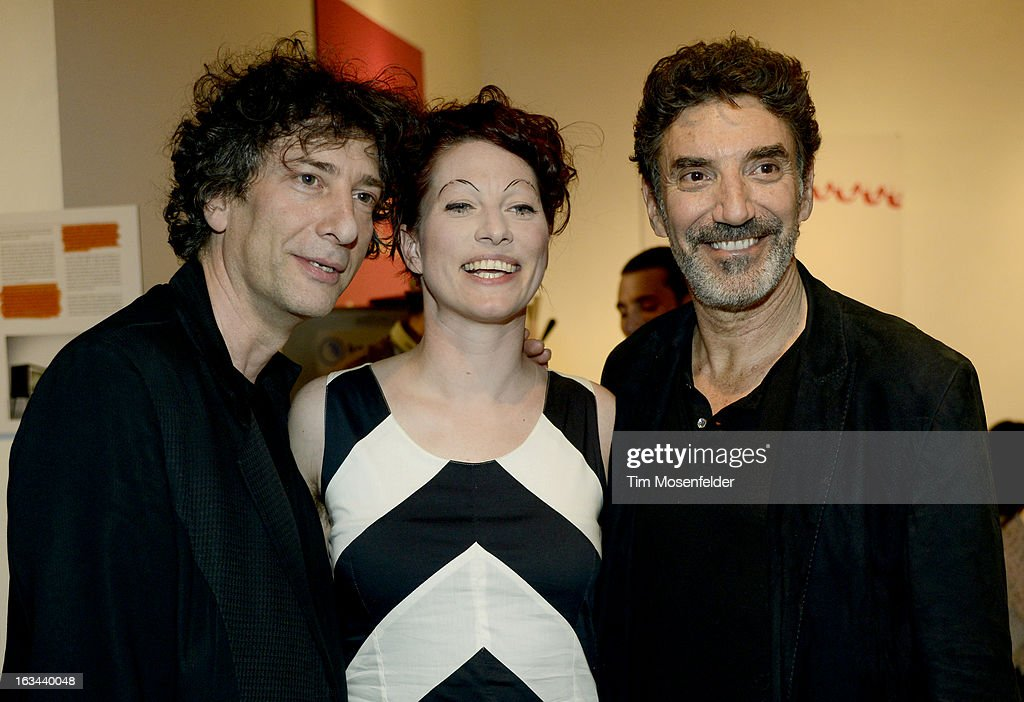 Neil Gaiman, Amanda Palmer, and Chuck Lorre pose at the Warner Brothers TV 2013 SXSW party on March 9, 2013 in Austin, Texas.