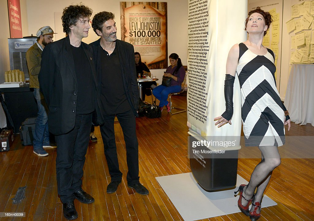Neil Gaiman, Chuck Lorre, and Amanda Palmer pose at the Warner Brothers TV 2013 SXSW party on March 9, 2013 in Austin, Texas.