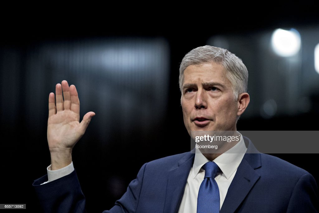 Neil Gorsuch, U.S. Supreme Court nominee for U.S. President Donald Trump, is sworn in during a Senate Judiciary Committee confirmation hearing in Washington, D.C., U.S., on Monday, March 20, 2017. Gorsuch goes before a Senate committee as a heavy favorite, given Republican control, to win confirmation to a lifetime seat on the nations highest court. Photographer: Andrew Harrer/Bloomberg via Getty Images