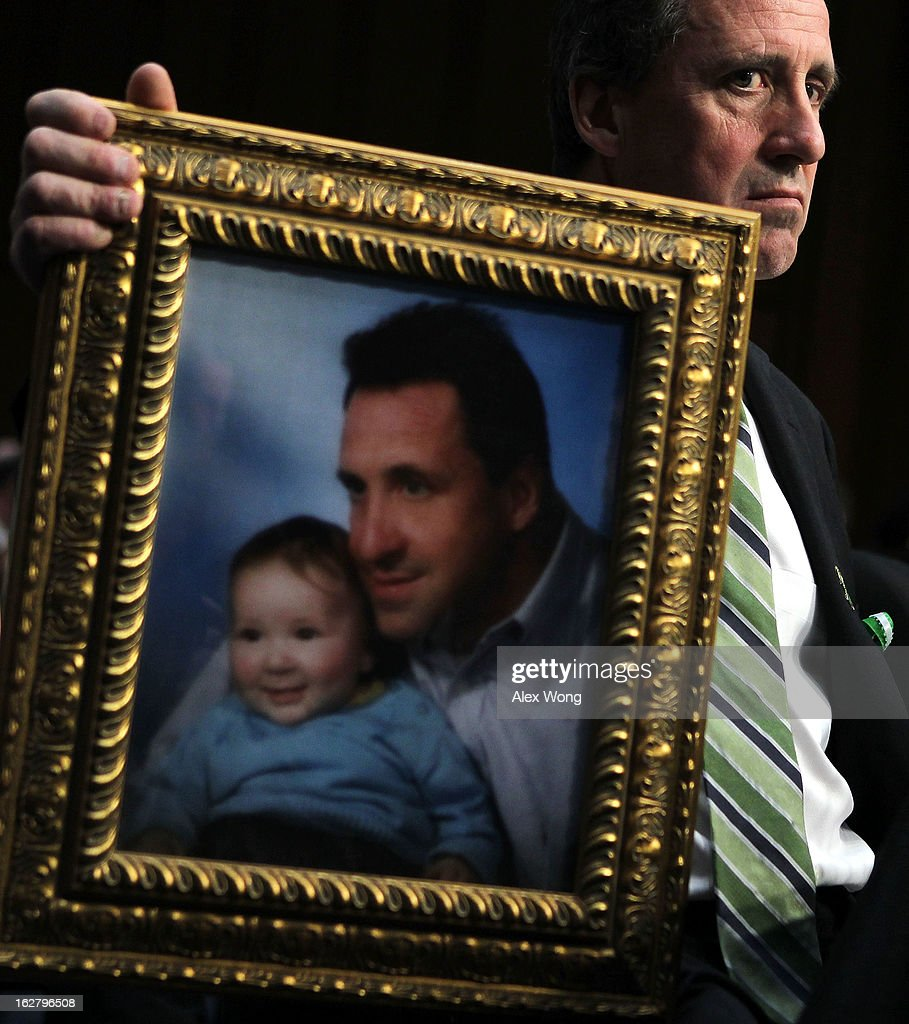 Neil Heslin, father of six-year-old Sandy Hook Elementary School shooting victim Jesse Lewis, holds a picture of him with Jesse as he testifies during a hearing before the Senate Judiciary Committee February 27, 2013 on Capitol Hill in Washington, DC. The committee held a hearing on 'The Assault Weapons Ban of 2013.'