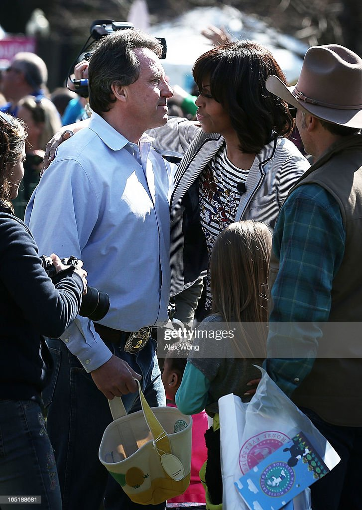 Neil Heslin (L), father of six-year-old Sandy Hook Elementary School shooting victim Jesse Lewis, is greeted by first lady <a gi-track='captionPersonalityLinkClicked' href=/galleries/search?phrase=Michelle+Obama&family=editorial&specificpeople=2528864 ng-click='$event.stopPropagation()'>Michelle Obama</a> (R) during the annual White House Easter Egg Roll on the South Lawn of the White House April 1, 2013 in Washington, DC. President Obama and first lady <a gi-track='captionPersonalityLinkClicked' href=/galleries/search?phrase=Michelle+Obama&family=editorial&specificpeople=2528864 ng-click='$event.stopPropagation()'>Michelle Obama</a> hosted thousands of people during the annual celebration of Easter.