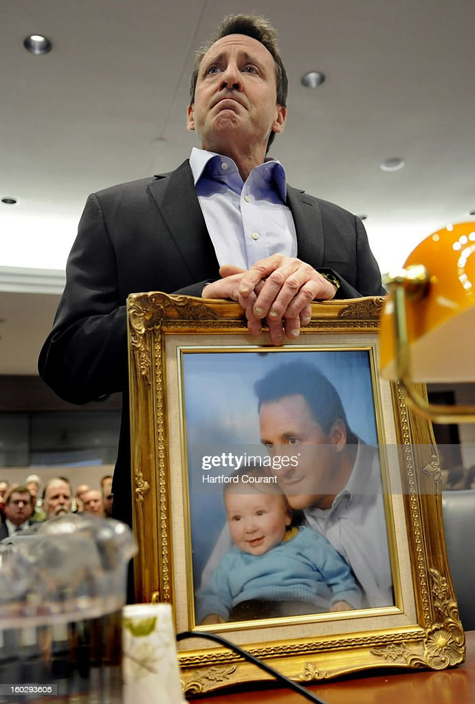 Neil Heslin holds a framed photograph of himself taken with his son Jesse, whom was a baby at the time, while appearing at a hearing of the legislature's Bipartisan Task Force On Gun Violence Prevention and Children's Safety at the legislative office building in Hartford, Connecticut, Monday, January 28, 2013. Jesse, 6, was one of the twenty children killed in the Sandy Hook massacre. 'Jesse was my buddy and my best friend,' Heslin said.