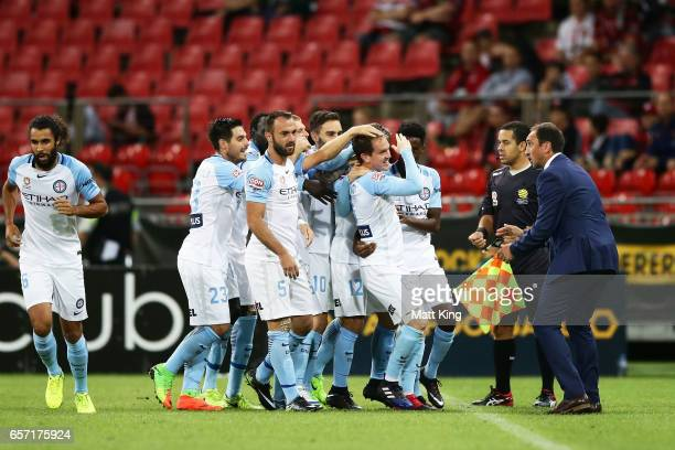 Neil Kilkenny of Melbourne City celebrates with team mates after scoring a goal during the round 24 ALeague match between the Western Sydney...