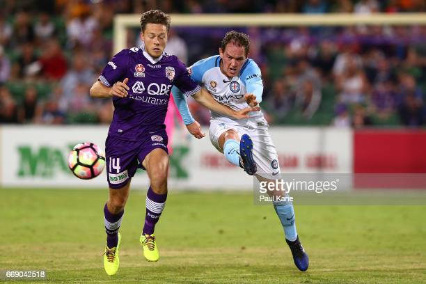 Neil Kilkenny of Melbourne crosses the ball againt Chris Harold of the Glory during the round 27 ALeague match between the Perth Glory and Melbourne...