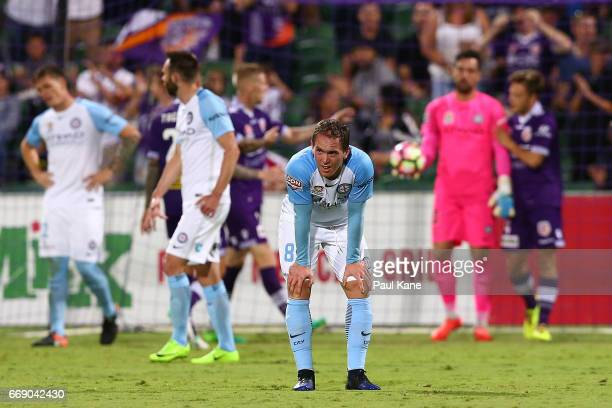 Neil Kilkenny of Melbourne looks on after a goal by Chris Harold of the Glory during the round 27 ALeague match between the Perth Glory and Melbourne...