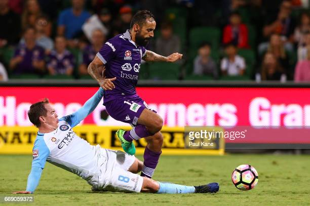Neil Kilkenny of Melbourne tackles Diego Castro of the Glory during the round 27 ALeague match between the Perth Glory and Melbourne City FC at nib...