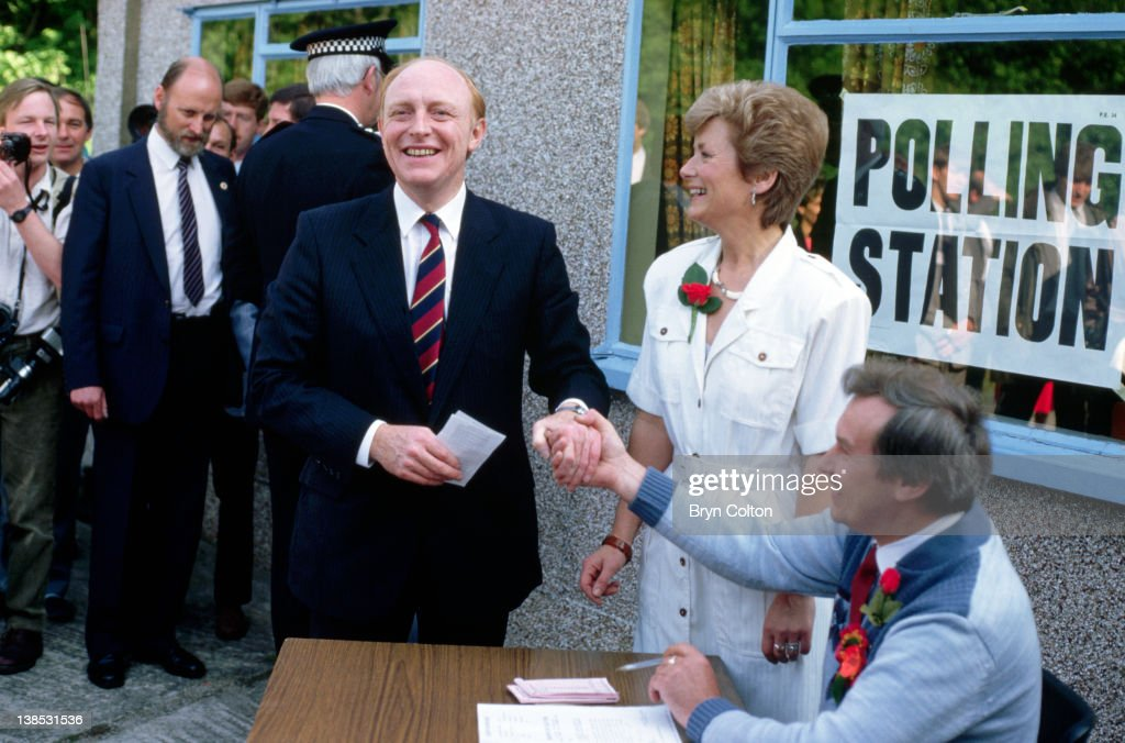 <a gi-track='captionPersonalityLinkClicked' href=/galleries/search?phrase=Neil+Kinnock&family=editorial&specificpeople=178980 ng-click='$event.stopPropagation()'>Neil Kinnock</a>, Labour Party Leader, center, and his wife Glenys Kinnock, center right, collect their ballot papers at the Pontllanfraith polling station ahead of voting in the U.K. general election in his Islwyn constituency in Pontllanfraith, United Kingdom, on Thursday, June 11, 1987.