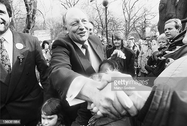 Neil Kinnock on the campaign trail pressing the flesh reaching out to shake hands 2nd April 1992