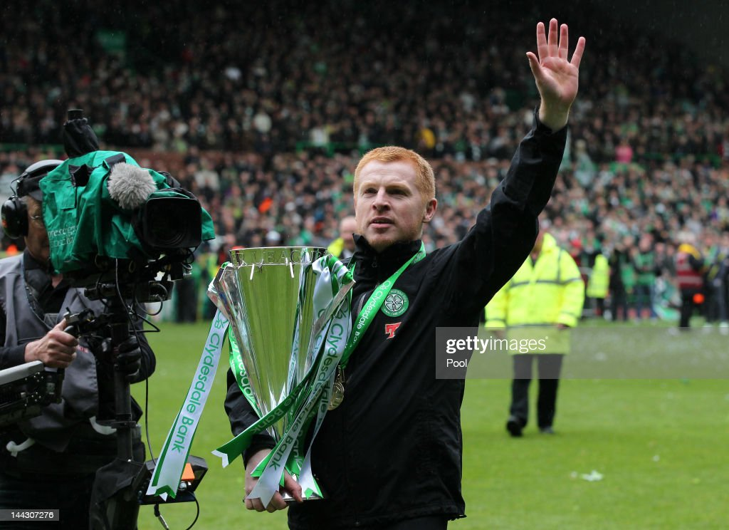 <a gi-track='captionPersonalityLinkClicked' href=/galleries/search?phrase=Neil+Lennon&family=editorial&specificpeople=642944 ng-click='$event.stopPropagation()'>Neil Lennon</a> coach of Celtic celebrates with the Clydesdale Bank Premier League trophy following the Clydesdale Bank Premier League match between Celtic and Hearts, at Celtic Park on May 13, 2012 in Glasgow, Scotland.
