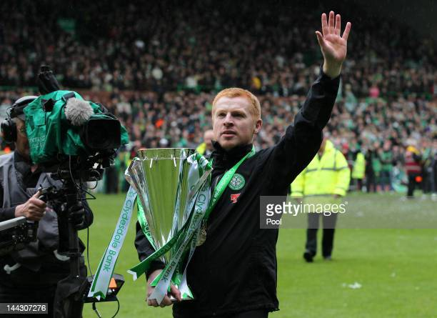 Neil Lennon coach of Celtic celebrates with the Clydesdale Bank Premier League trophy following the Clydesdale Bank Premier League match between...